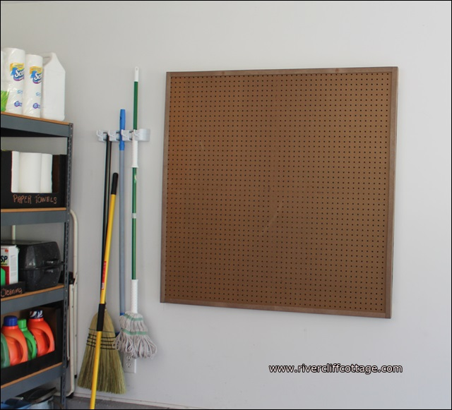 Pegboard empty with broom hanger