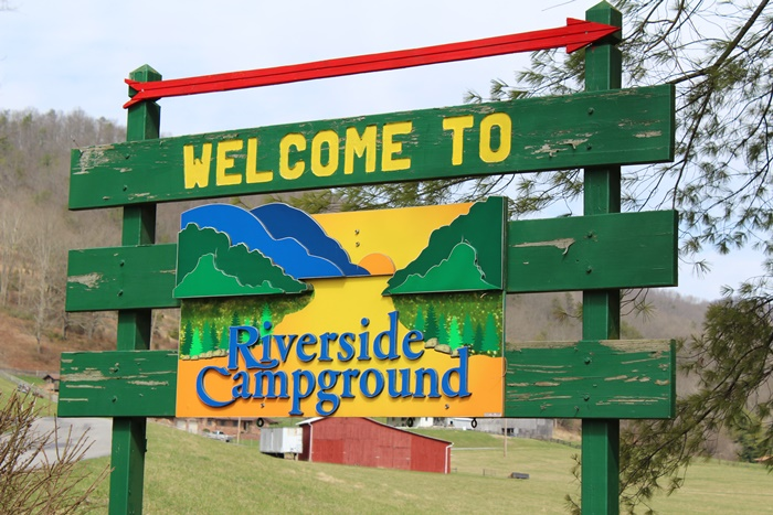 Riverside Campground sign in front
